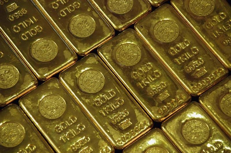 Gold shines on falling dollar, yields; pandemic cost concerns drag on shares