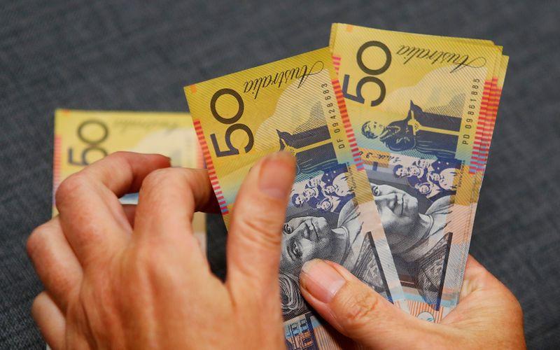 Aussie dollar near six-week peak as easing lockdowns spur risk